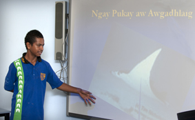Student presenting using a projector screen